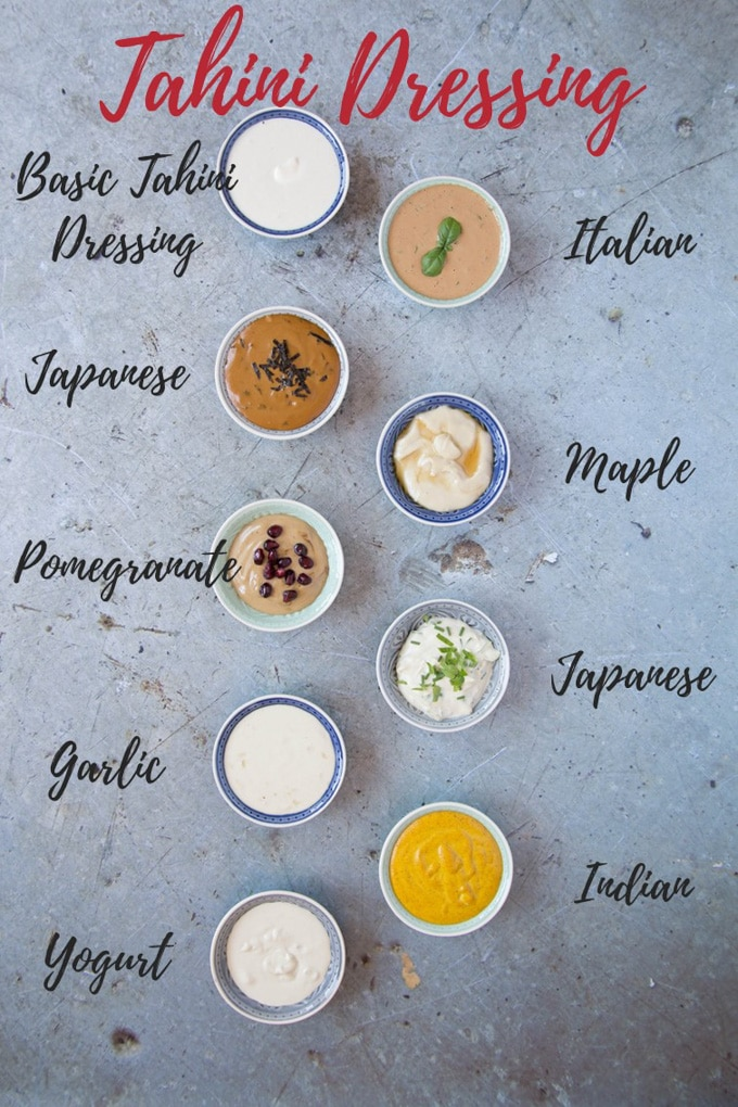 An overhead shot of a 9 small dip bowls of tahini dressing in different flavours