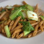 Spelt pasta with soy sauce olive oil and pak choy