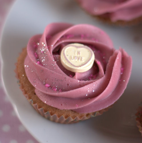 Valentines cupcakes with pink frosting and love hearts