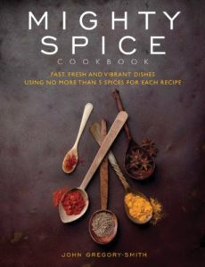 Cover of Mighty Spice book. Spoons of spices on a dark background.