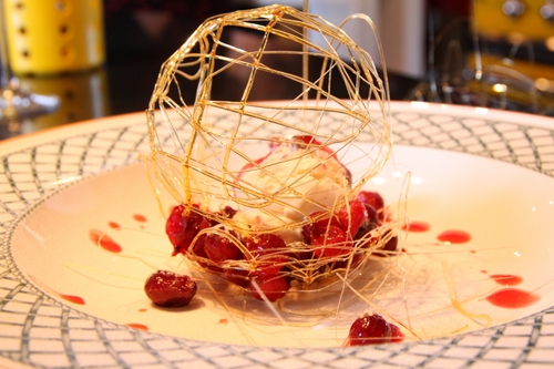 Cranberries in a basket with a caramel cage