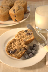 Wheat biscuit and blueberry muffins plated