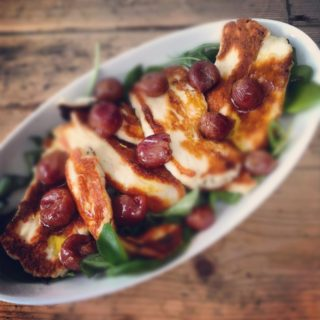Pomegranate molasses baked grapes with fried halloumi