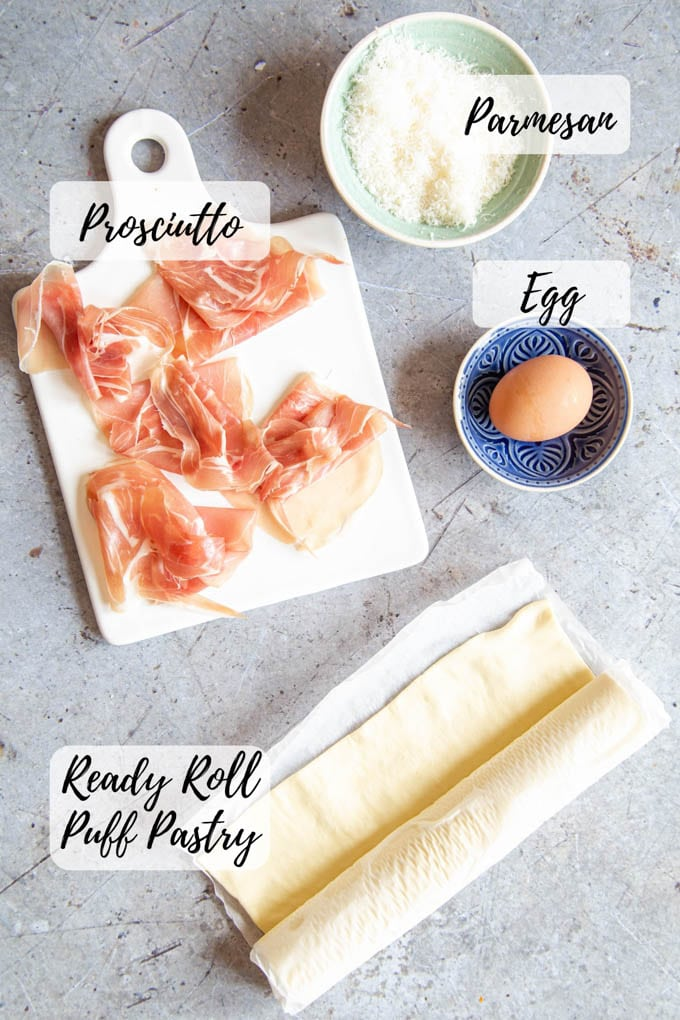 Ingredients for prosciutto cheese twists - pastry, grated cheese, ham and an egg.