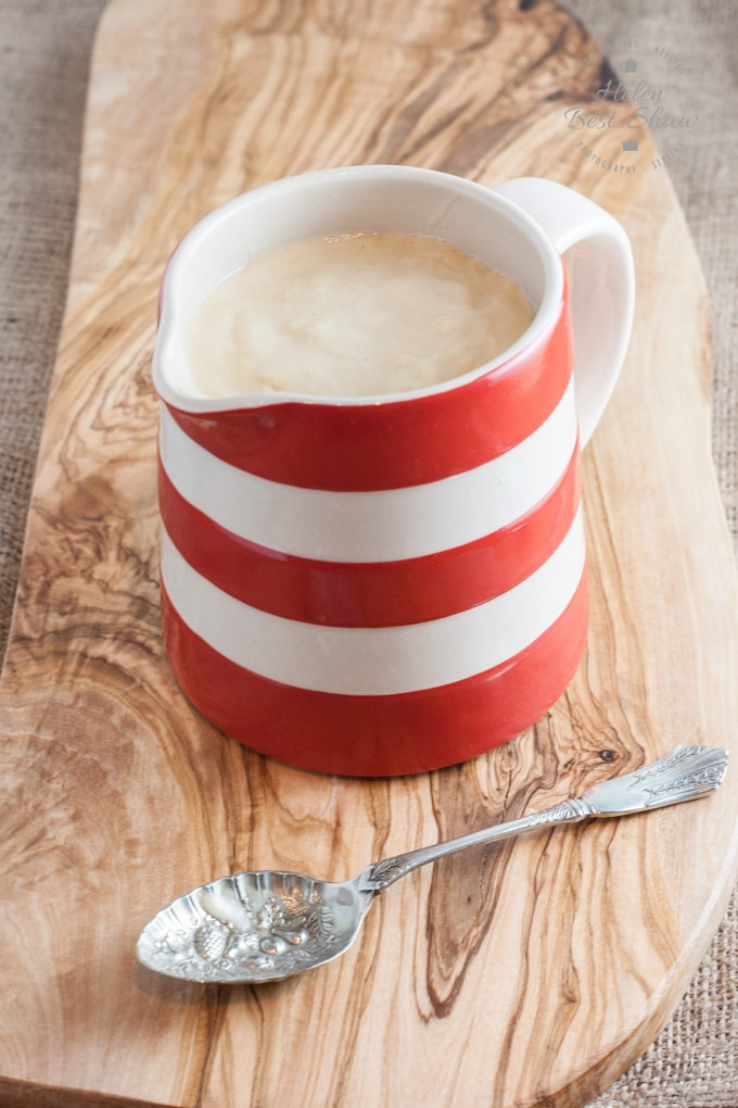 A red and white striped jug full of custard made in the power blender