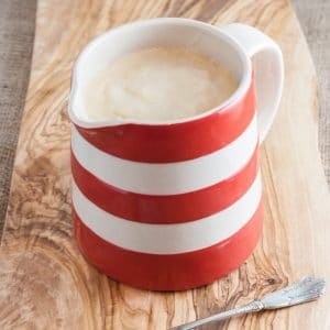 A red and white striped jug of power blender custard