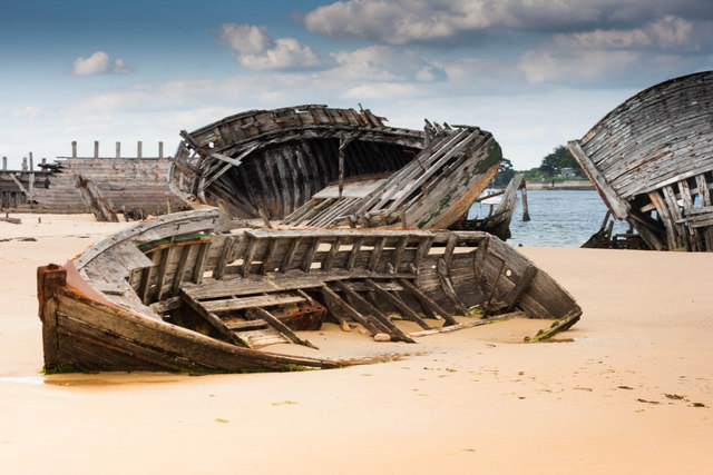 Old Tuna fishing boats abandoned on the beach at Etel