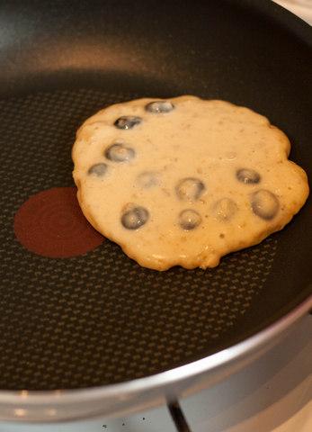 Mango blueberry pancake frying in Tefal pan_