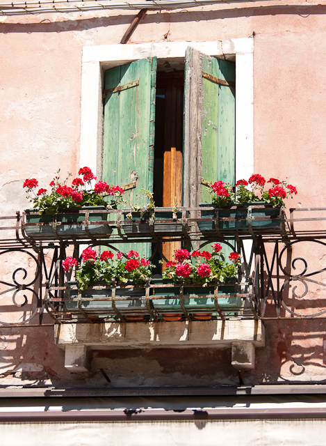 Weather beaten, typically green shutters. Italian Castello Quarter of Venice