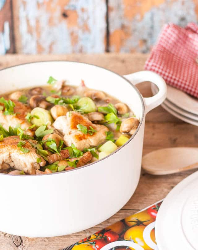 A simple French chicken casserole with bacon and packed with vegetables - leeks, shallots and mushrooms, cooked on the stove top