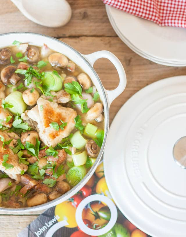 A simple French style chicken casserole with bacon and packed with vegetables - leeks, shallots and mushrooms, cooked on the stove top