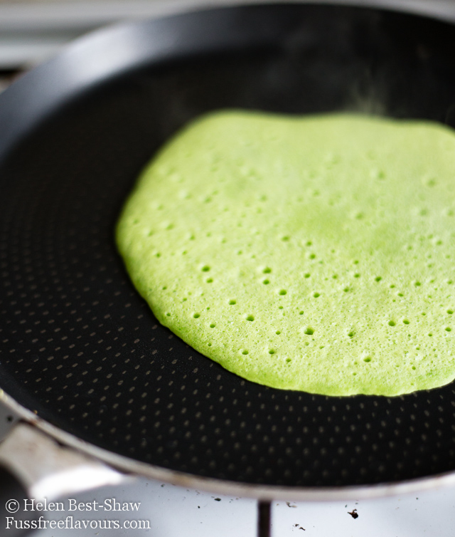 green pancake ready to flip