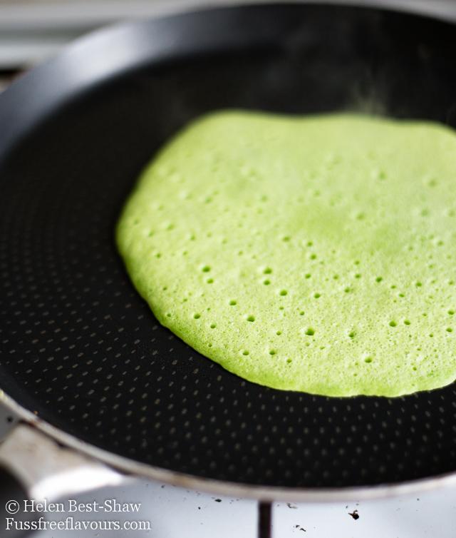 green pancake ready to flip