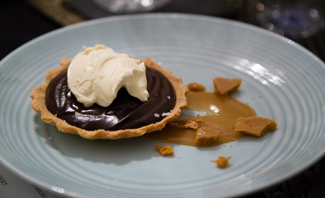 Chocolate tart with salted caramel sauce, honeycomb and clotted cream