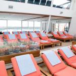 Indoor poolside seating on board Celebrity Eclipse