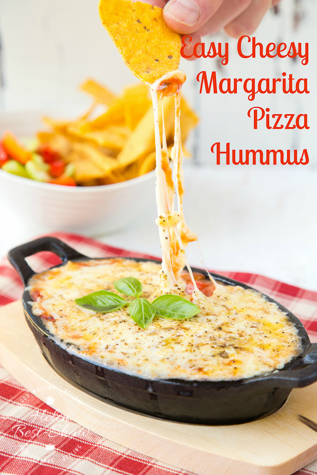 An easy vegetarian 4 ingredient recipe for baked hummus covered in pizza sauce and lots of melted cheese. Dip meets pizza is so delicious!