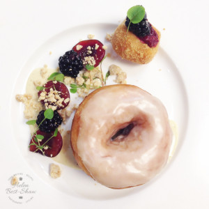 lackberry doughnuts with a maple glaze and vanilla creme anglaise