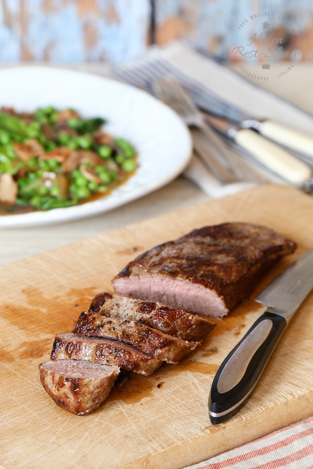 This recipe for tender loin of lamb with a classic combination of peas, lettuce and bacon makes a perfect spring supper.