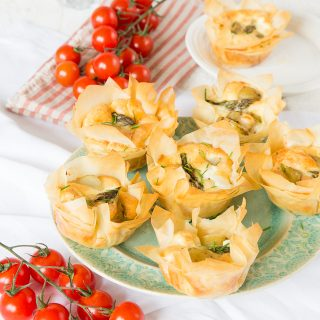 These individual vegetarian filo tarts are filled with new season potatoes, asparagus & goats cheese. Perfect for picnics.