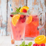 This refreshing cranberry, raspberry and orange mocktail is made with a surprising secret ingredient - Ricola boiled sweets!