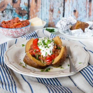 Slow cooked baked potatoes with corned beef ragu