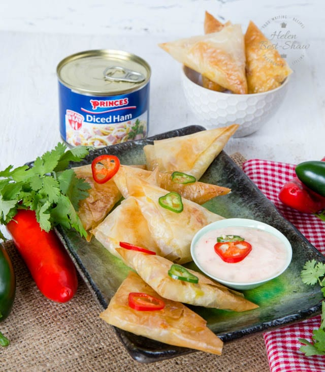 Samosas are fantastically easy to make, as well as adaptable. These are filled with cooked rice, diced ham, leftover roast chicken and some sweetcorn. These are great to serve at a party, and ideal for older children to help fold.