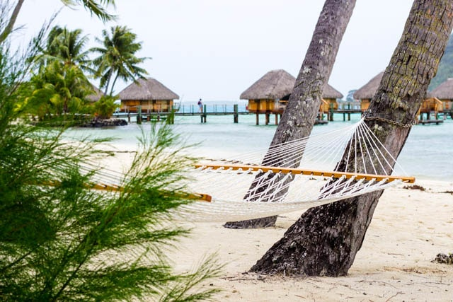 Relax in a beach hammock in Bora Bora