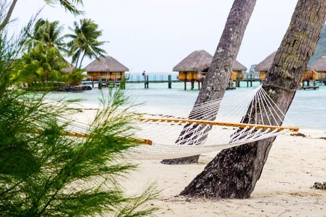 Relax in a beach hammock in Bora Bora