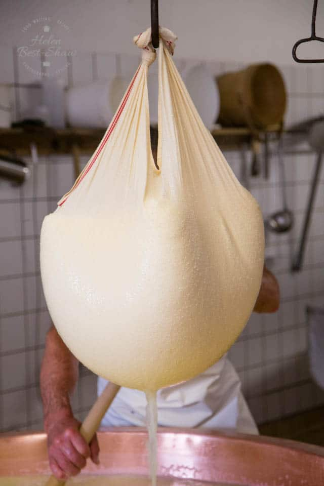 Cheesecloth full of curds