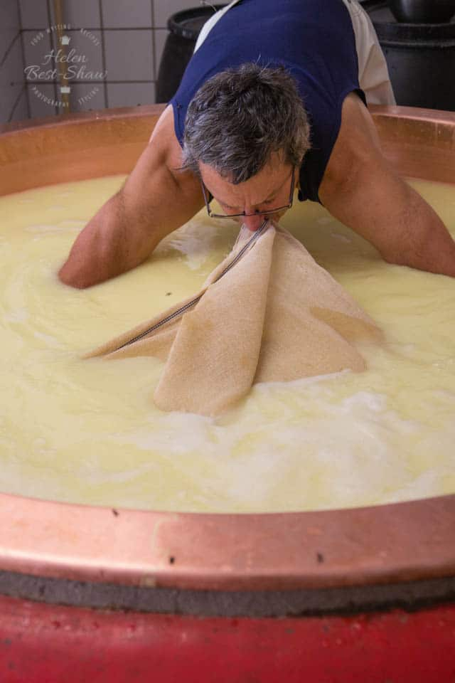 Straining the curds from the whey