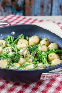 A delicious dish of creamy Creamy Majorcan new potatoes with spring vegetables