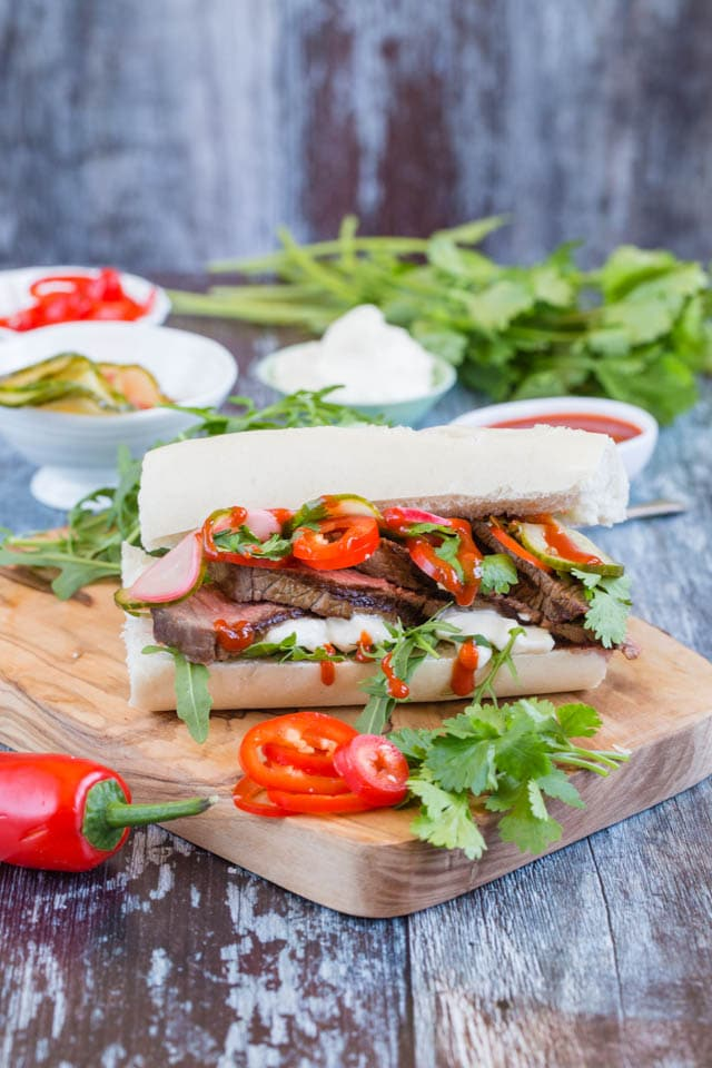 Pile up the fillings high in this beef bánh mì, with a crunch of quick pickles and a hint of chili heat - Street food at its best