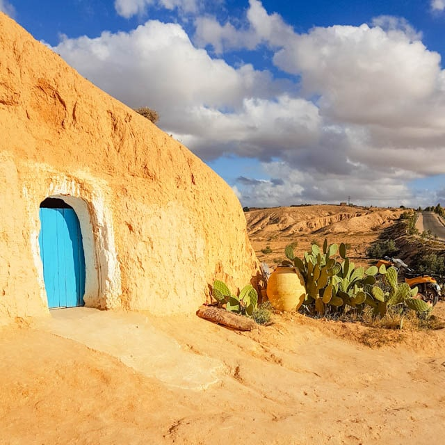 Traditional Berber homes carved out of the desert rock