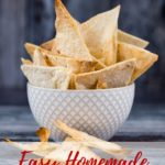 A white textured bowl containing homamde crispy tortilla chips, against a dark background. Teext overlay reading Easy Homemde Tortilla Chips