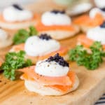 Rich and savoury buckwheat sourdough blinis, topped with smoked salmon, sour cream and fish roe