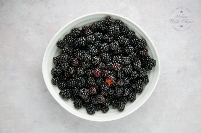 Bowl of wild foraged blackberries viewed from above