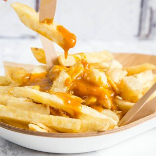 A wicked treat: a bowlful of thick cut chips dripping with homemade takeaway Chinese curry sauce.