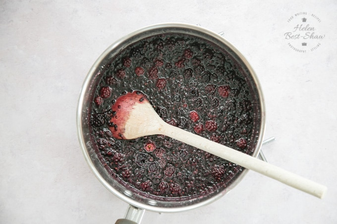 A pan of blackberries and sugar viewed from above
