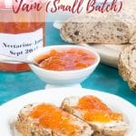 Two slices of brown bread on a white plate covered in bright orange nectarine jam. A bowl and jar of jam are in the background. Text overlay reads Easy Nectarine Jam (small batch)
