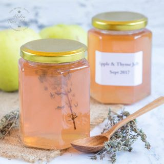 A pot of delicious home-made traditional apple jelly with thyme.