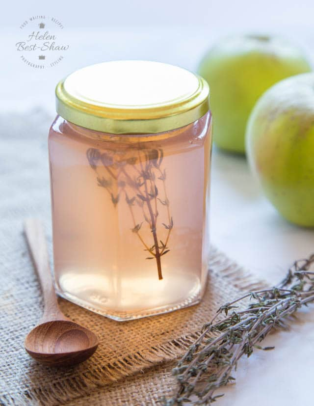 Delicious pale pink apple jelly, with a sprig of thyme.