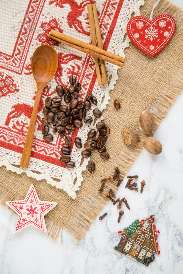 Coffee beans and spices - cinnamon, nutmeg and cloves - for our homemade spiced festive cold brew coffee