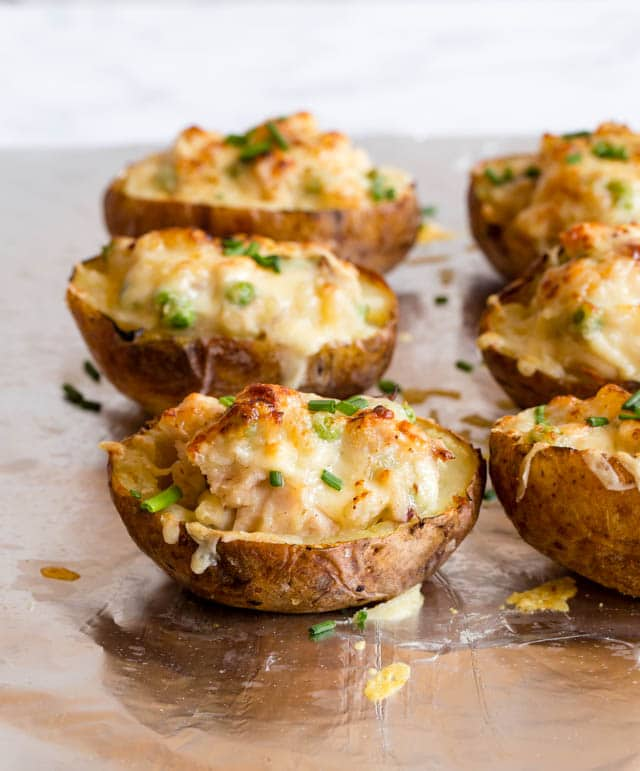Delicious twice baked potatoes, stuffed with turkey, ham and cheese. Perfect for Christmas leftovers!
