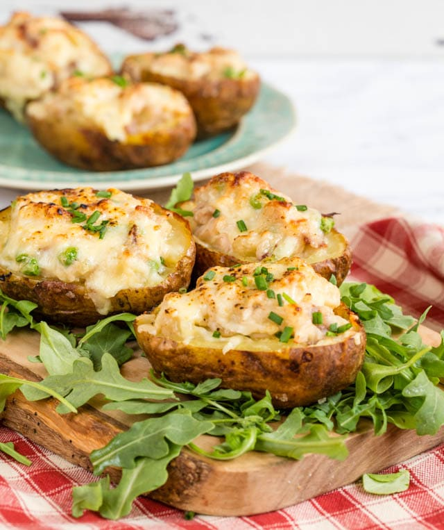 Economical twice baked potatoes stuffed with cheese, ham and turkey.