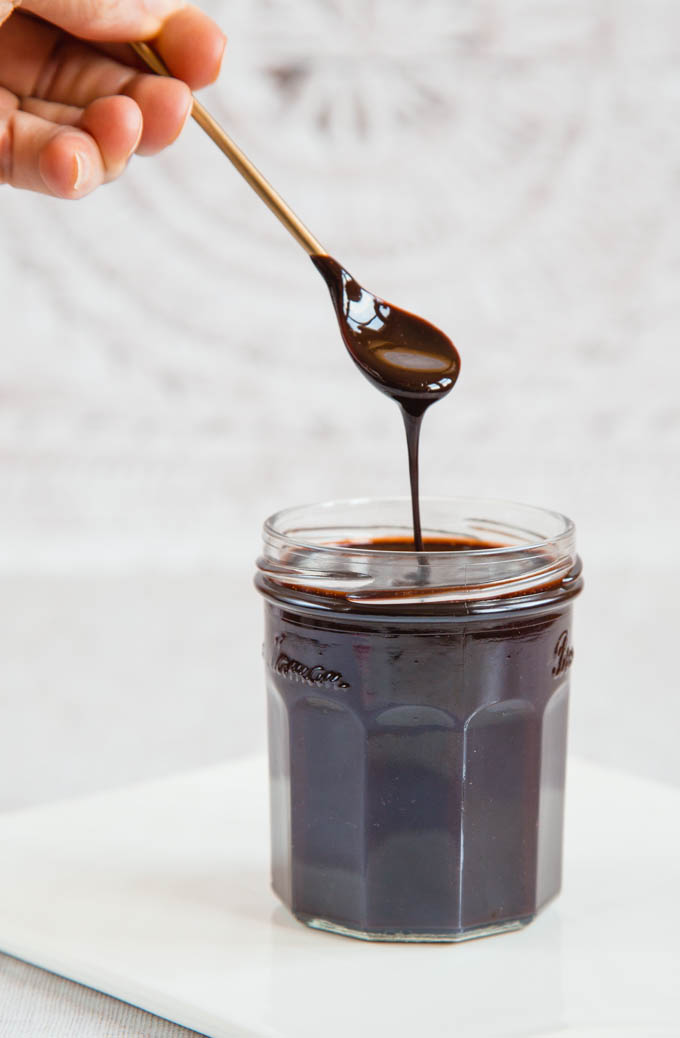a jar of rich dark 2 ingredient vegan chocolate sauce