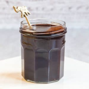 jar of dark and rich vegan chocolate sauce, made with just two ingredients