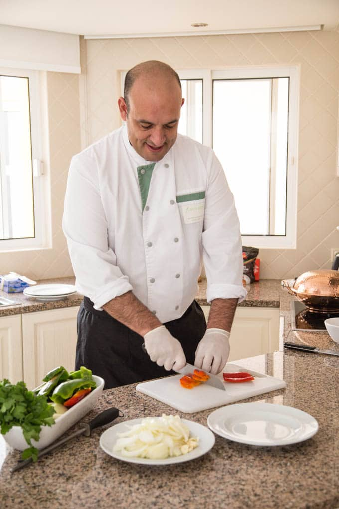 Nelson Candeias executive chef at Four Seasons Fairways in a domestic kitchen chopping red peppers