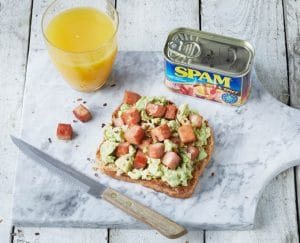 Hot and spicy SPAM and aovcado toast, served with orange juice for a quick and easy brunch bite.