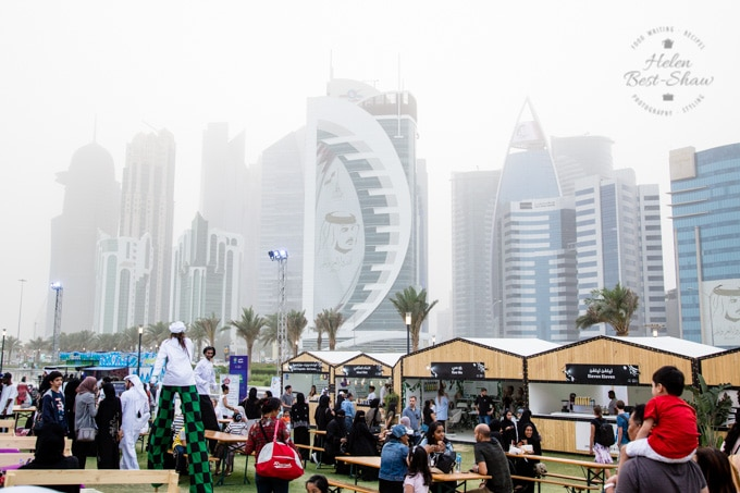 Stalls at the Qatar International Food Festival with sky scrapers in the background