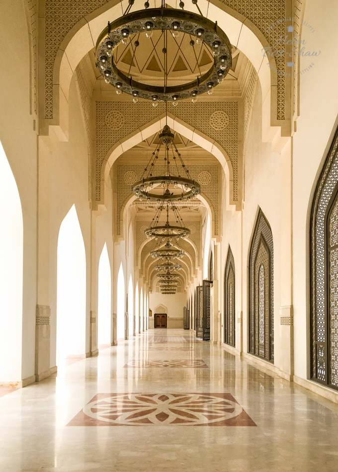 Arched marble lined walk way in the grand Mosque Doha
